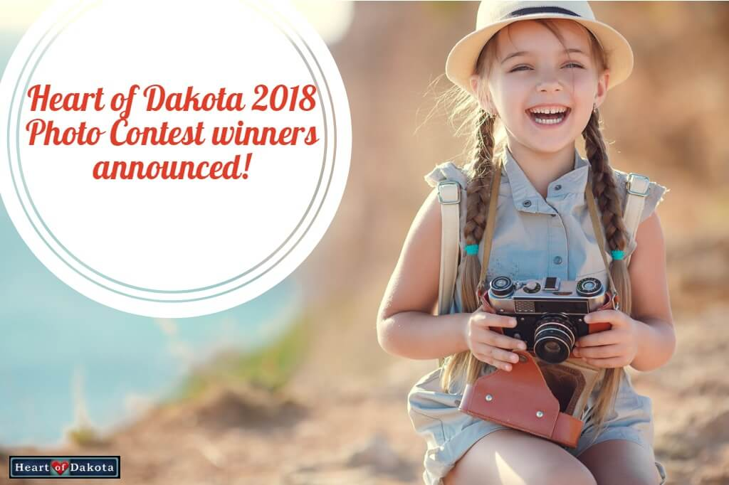 Heart of Dakota 2018 Photo Contest winners announced! - Photo of a smiling little girl at the seaside holding a vintage camera