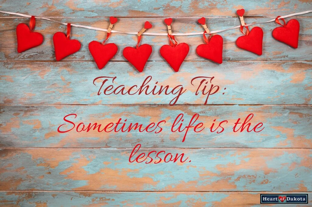 Heart of Dakota Teaching Tip: Sometimes Life is the Lesson - picture of multiple red felt hearts hanging on a clothesline against a background of distressed cyan-colored wood