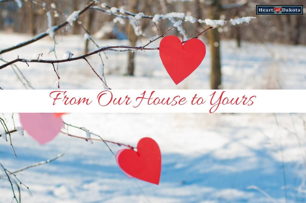 Heart of Dakota From Our House to Yours - picture of a snowy forest landscape with red wooden hearts hung on the bare, snow-covered branches of the trees