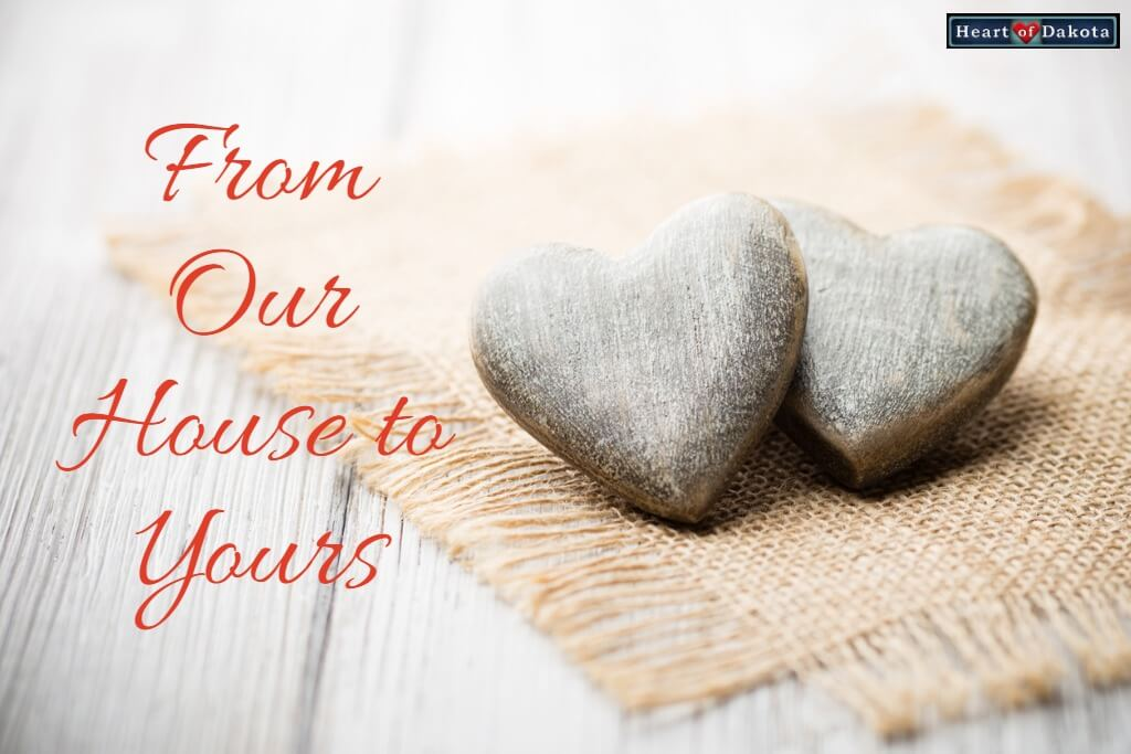 Heart of Dakota From Our House to Yours - photo of two stone hearts nestled together, sitting on a tiny cloth mat.