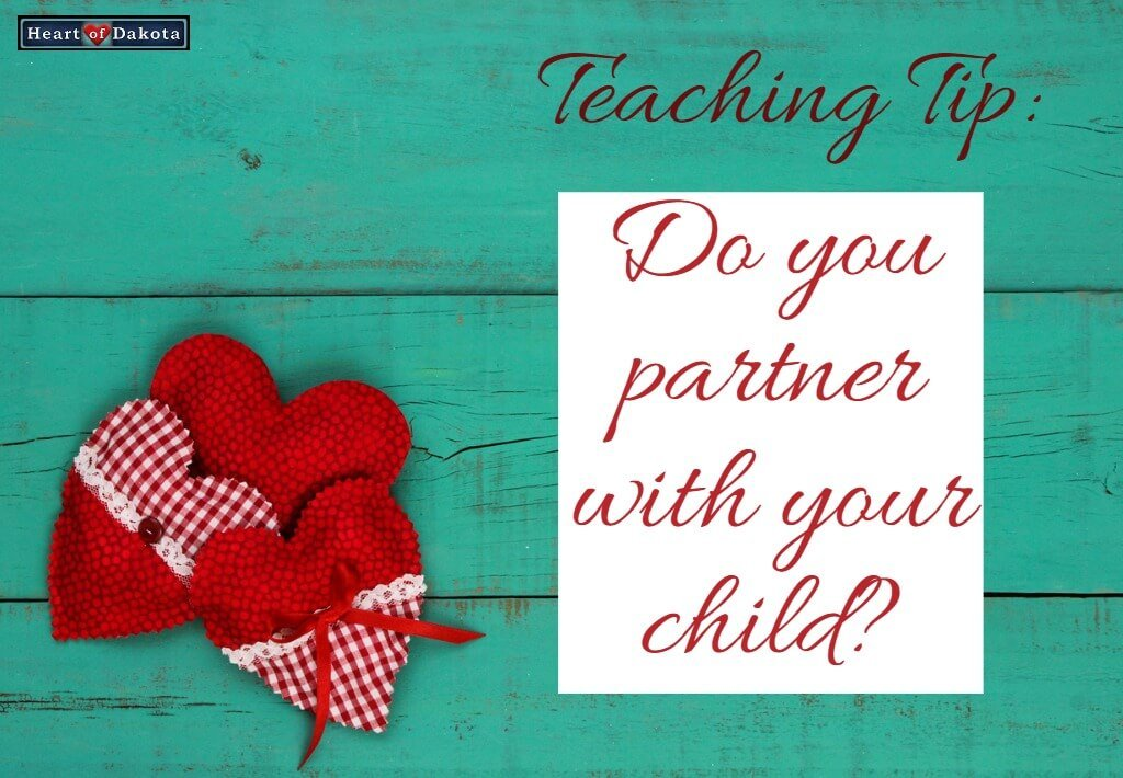 """Two plaid red hearts laying on a teal wood surface. A text placard to the right reads """"Do you partner with your child?"""""""